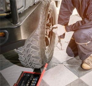 how to get a rounded lug nut off